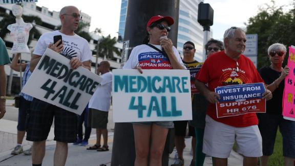FORT LAUDERDALE, FL - JULY 24: PJ Espinal (C) joins with other protesters against Republican senators who have not spoken up against Affordable Care Act repeal and demand universal, affordable, quality healthcare for all on July 24, 2017 in Fort Lauderdale, United States. The U.S. Senate is expected to vote tomorrow on the health care legislation after they twice postponed the vote.  (Photo by Joe Raedle/Getty Images)