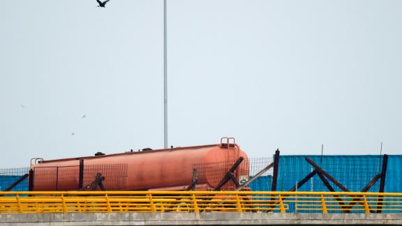 An oil tanker and two large containers blocked passage across the Tienditas Bridge on Wednesday.