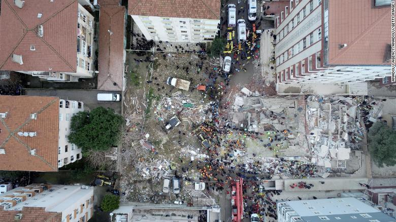 A drone photo shows the rescue operation underway after the building in an eastern district of Istanbul collapsed Wednesday.