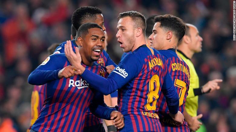 Barcelona's Brazilian midfielder Malcom celebrates after drawing his side level.