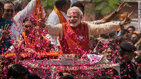 Narendra Modi is covered in flower petals while campaigning in Vadodra, India this week.