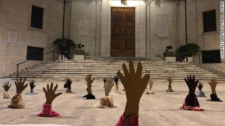 'Drowning hands' guerrilla artwork protests Italy's hard line on migrants