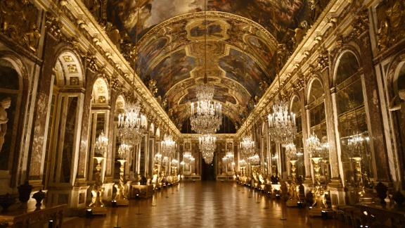 TOPSHOT - A picture taken on March 6, 2017 shows a view of the galerie des Glaces (Hall of Mirrors) painted by French artist Charles Le Brun (1619-1690) at the Versailles Castle, west of Paris. / AFP PHOTO / Martin BUREAU        (Photo credit should read MARTIN BUREAU/AFP/Getty Images)