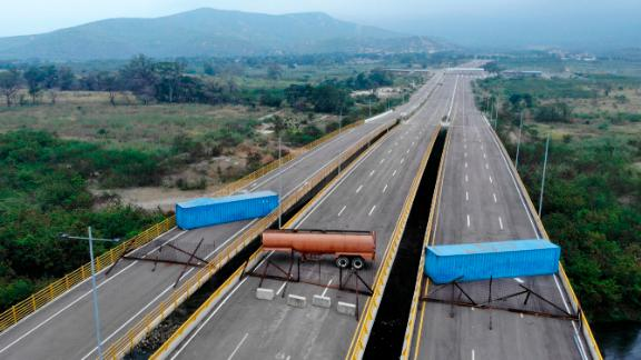 Aerial view of the Tienditas Bridge, in the border between Cucuta, Colombia and Tachira, Venezuela, after Venezuelan military forces blocked it with containers on February 6, 2019. - Venezuelan military officers blocked a bridge on the border with Colombia ahead of an anticipated humanitarian aid shipment, as opposition leader Juan Guaido stepped up his challenge to President Nicolas Maduro's authority. (Photo by EDINSON ESTUPINAN / AFP)        (Photo credit should read EDINSON ESTUPINAN/AFP/Getty Images)