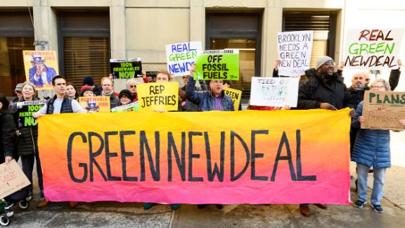 BROOKLYN, NY, UNITED STATES - 2019/02/04: Demonstrators seen holding a huge banner saying, green new deal during the protest. 350.org, Food & Water Watch and other groups organized a protest to encourage U.S. Representative Hakeem Jeffries (D-NY) to support the Green New Deal. Protest was held in front of the Hanson Place office building in Brooklyn, NY. (Photo by Michael Brochstein/SOPA Images/LightRocket via Getty Images)