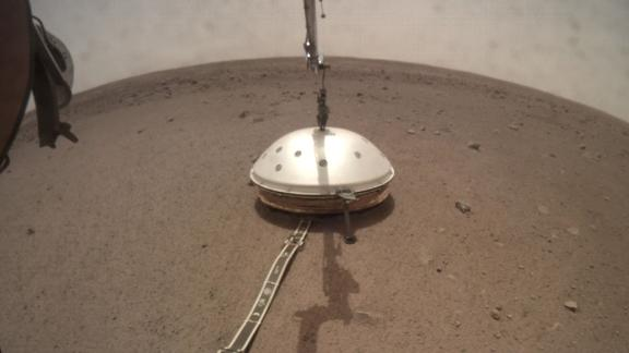 NASA's InSight lander deployed its Wind and Thermal Shield to cover InSight's seismometer.