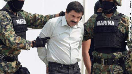 "Mexican drug trafficker Joaquin Guzman Loera aka ""el Chapo Guzman"" (C), is escorted by marines as he is presented to the press on February 22, 2014 in Mexico City. Mexican drug lord Joaquin ""El Chapo"" Guzman has escaped from a maximum-security prison for the second time in 14 years, sparking a massive manhunt Sunday and dealing an embarrassing blow to the government. AFP PHOTO/Alfredo Estrella        (Photo credit should read ALFREDO ESTRELLA/AFP/Getty Images)"