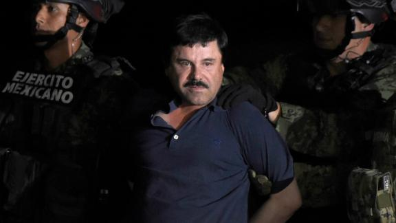 "TOPSHOT - Drug kingpin Joaquin ""El Chapo"" Guzman is escorted into a helicopter at Mexico City's airport on January 8, 2016 following his recapture during an intense military operation in Los Mochis, in Sinaloa State. Mexican marines recaptured fugitive drug kingpin Joaquin ""El Chapo"" Guzman on Friday in the northwest of the country, six months after his spectacular prison break embarrassed authorities.   AFP PHOTO / ALFREDO ESTRELLA / AFP / ALFREDO ESTRELLA        (Photo credit should read ALFREDO ESTRELLA/AFP/Getty Images)"