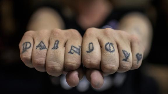 Foxxy Angel shows her tattooed knuckles.