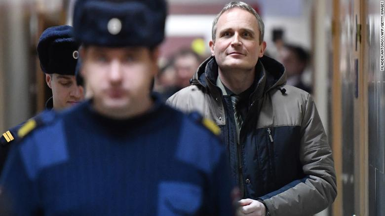 "Danish Jehovah's Witness Dennis Christensen is escorted inside a Russian courthouse after being sentenced to six years in prison for ""extremism."""