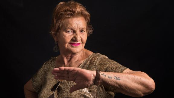 """Maria De Lourdes Araujo, 76, of Barreto, Brazil, shows off her """"I am a whore"""" tattoo. The sex work industry used to be filled with passion and glamour, she says, with dancing often used as a means of seduction. Today, the great-grandmother continues to see regular clients."""