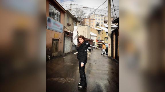Shaparak Shajarizadeh stands unveiled in an Iranian town waving a white scarf on a stick, as part of the anti-compulsory hijab protests of 2018.