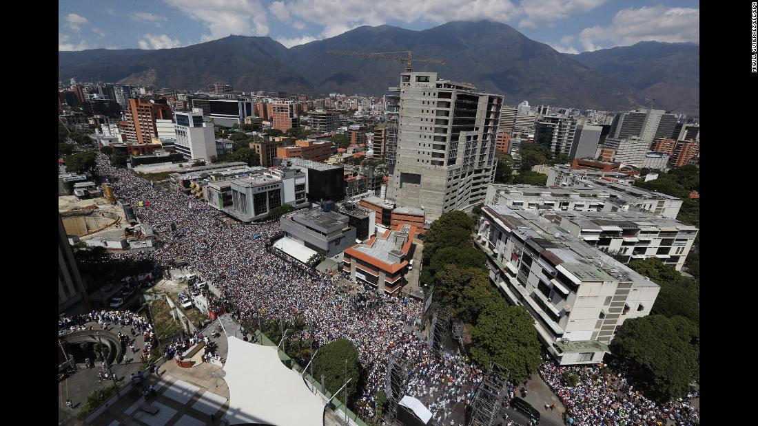 People march in an anti-government demonstration in Caracas, Venezuela, on Saturday, February 2. With his country facing a severe economic crisis, embattled Venezuelan President Nicolas Maduro is under increasing pressure from the United States and other countries to step down.