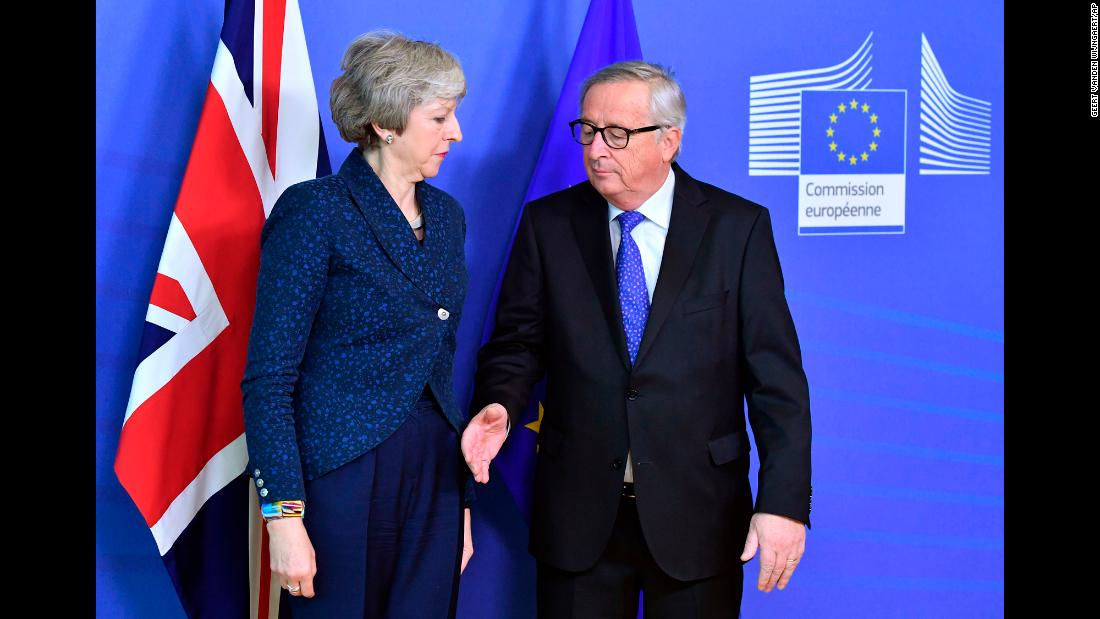 European Commission President Jean-Claude Juncker prepares to shake hands with British Prime Minister Theresa May before their meeting at the European Commission headquarters in Brussels, Belgium, on Thursday, February 7. British lawmakers voted last month to send May back to Brussels to renegotiate the terms of the Brexit deal.