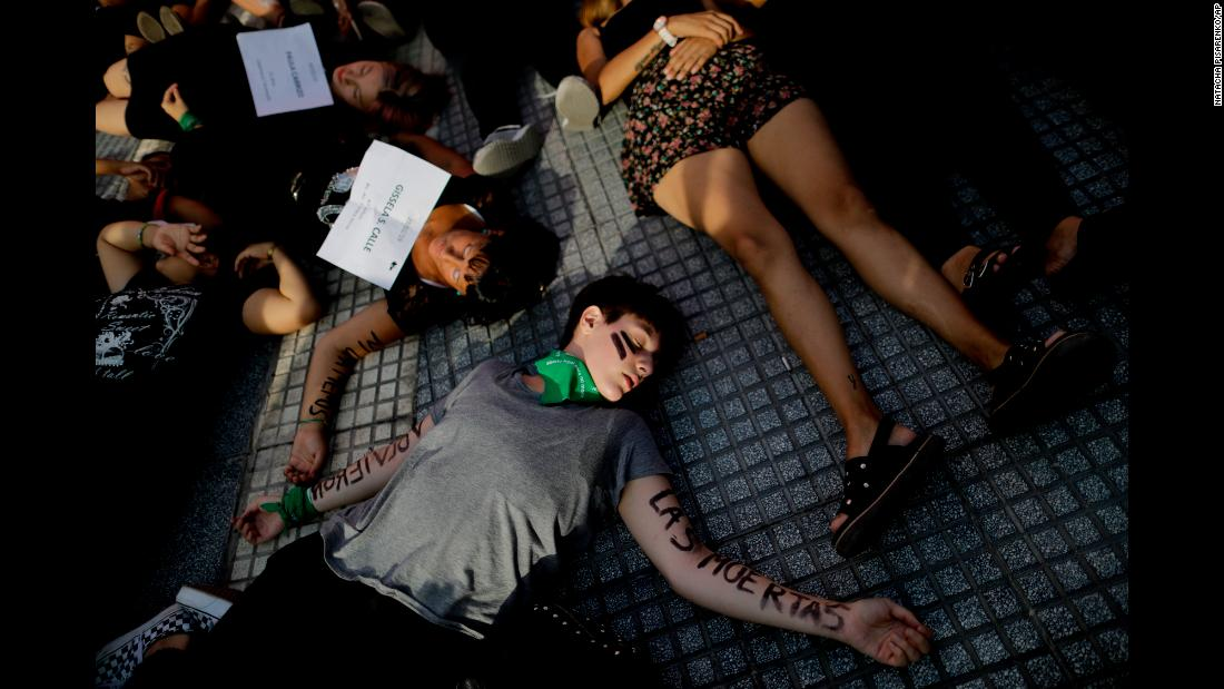 Women in Buenos Aires lie down on Plaza de Mayo square during a protest against gender violence on Friday, February 1.