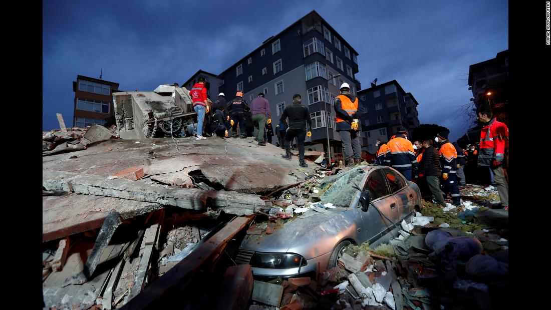 Rescue workers search for survivors at the site of a collapsed residential building in Istanbul on Wednesday, February 6.
