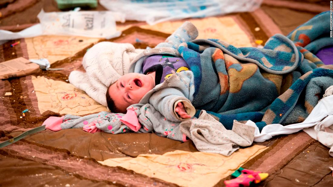 A baby cries at a camp for internally displaced people in al-Hol, Syria, on Wednesday, February 6.