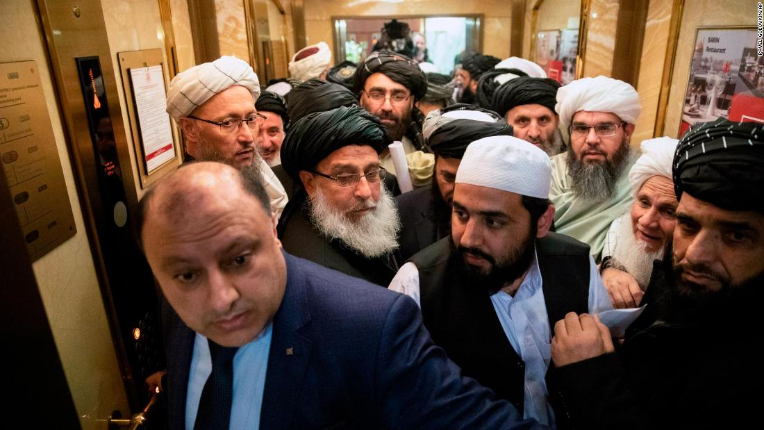 Taliban officials get into an elevator as they attend a conference in Moscow on Wednesday, February 6. The meeting brought together Taliban officials and some of Afghanistan's main political players, including several of the country's most powerful regional and ethnic leaders.