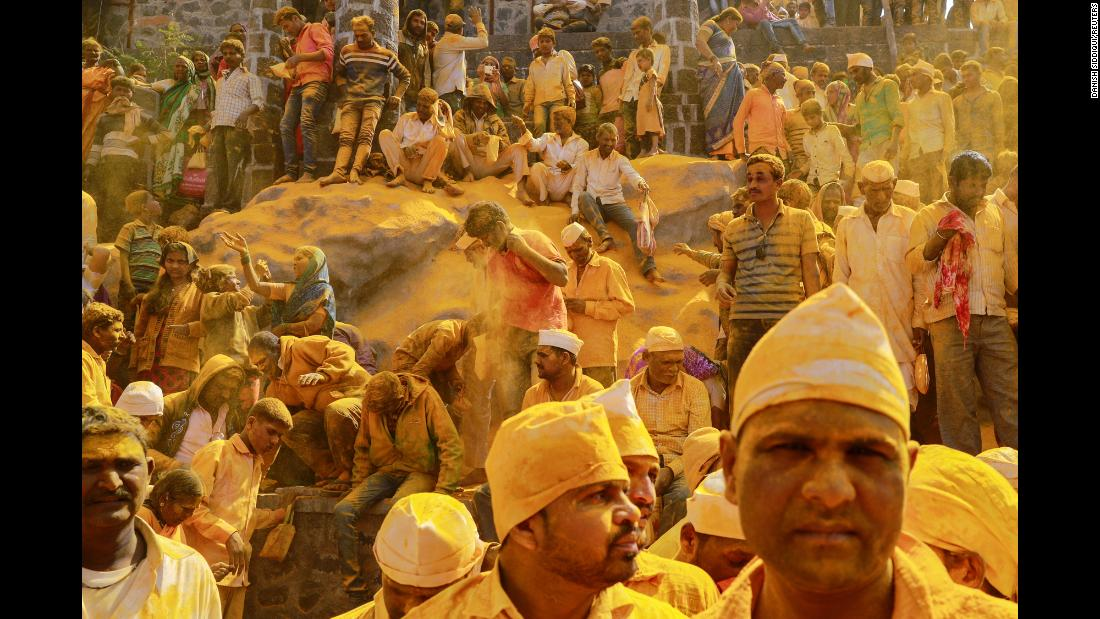 People wear turmeric powder as they watch a religious procession in Jejuri, India, on Monday, February 4.