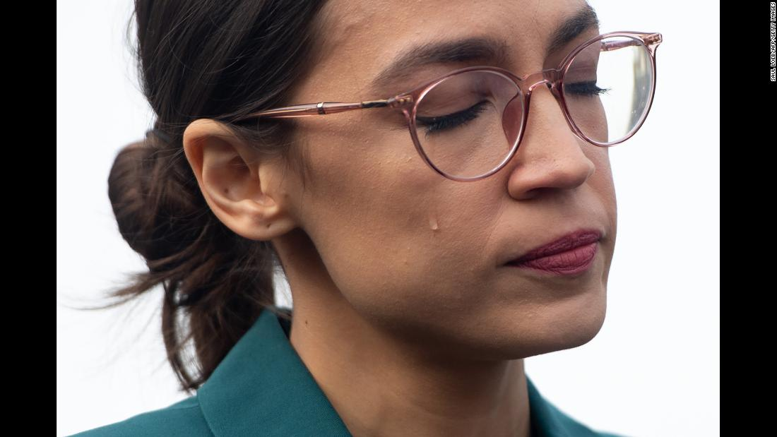 US Rep. Alexandria Ocasio-Cortez sheds a tear Thursday, February 7, during a Washington news conference calling on Congress to cut funding for US Immigration and Customs Enforcement. Ocasio-Cortez ran on a platform of abolishing the agency, which is more commonly known as ICE.