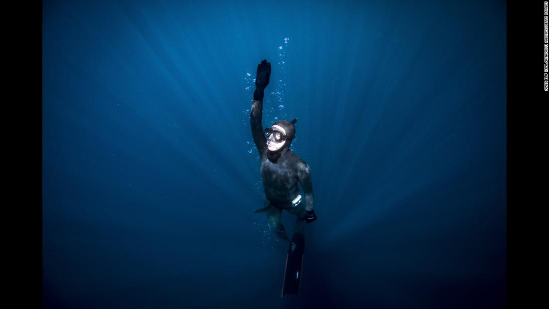 Sahika Ercumen, a member of a scientific research team from Turkey, dives in Antarctic waters on Monday, February 4.