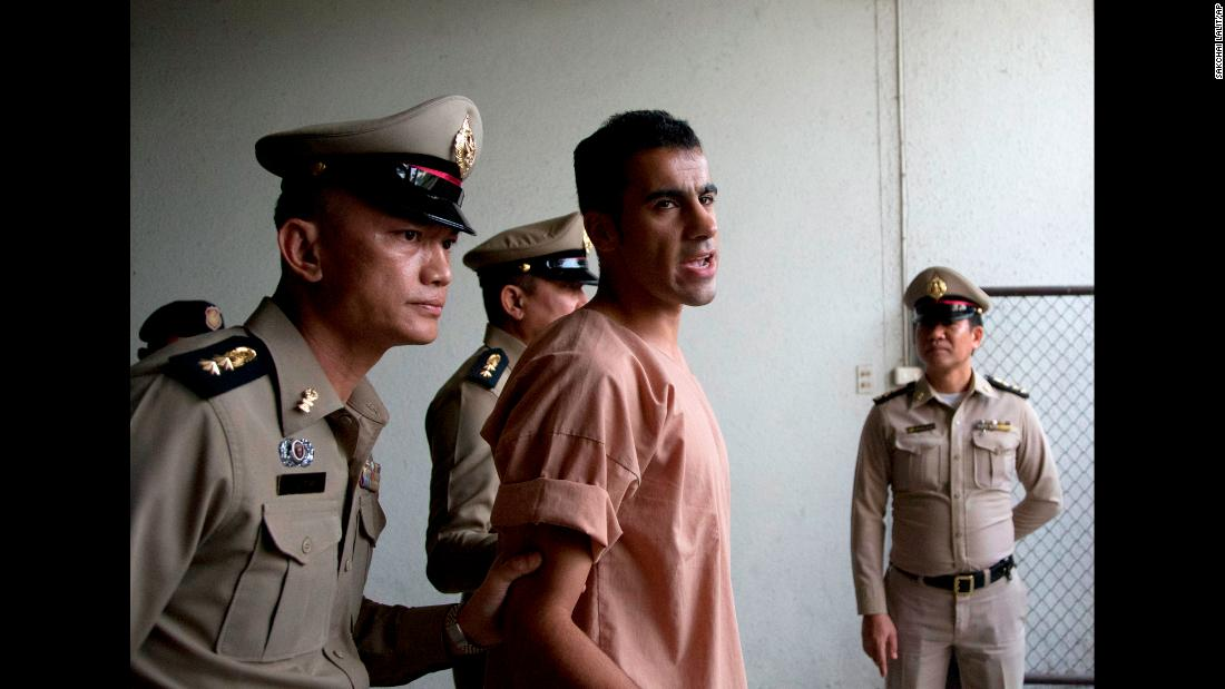 Hakeem al-Araibi, a semi-professional soccer player fighting extradition to Bahrain, leaves a criminal court in Bangkok, Thailand, on Monday, February 4. Al-Araibi, who plays for an Australian team and has refugee status in Australia, was on his honeymoon when he was detained by Thai officials at the request of Bahrain's government.