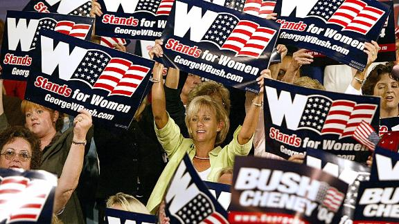 """Women cheer on US President George W. Bush as he arrives to deliver remarks on September 17, 2004, during a """"Focus On Women's Issues"""" event in Charlotte, North Carolina."""