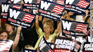 "Women cheer on US President George W. Bush as he arrives to deliver remarks on September 17, 2004, during a ""Focus On Women's Issues"" event in Charlotte, North Carolina."
