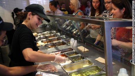 MIAMI, FL - APRIL 27:  Chipotle restaurant workers fill orders for customers on the day that the company announced it will only use non-GMO ingredients in its food on April 27, 2015 in Miami, Florida.  The company announced, that the Denver-based chain would not use the GMO's, which is an organism whose genome has been altered via genetic engineering in the food served at Chipotle Mexican Grills.  (Photo by Joe Raedle/Getty Images)