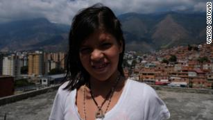 Rosbelis, 12, wants to escape the hunger and violence of Petare and become a photographer.