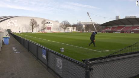 A groundsman prepares a pitch at Ajax's training ground.