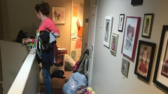 DeDe Alexander surveys her hallway after her blended family started following Marie Kondo's method.