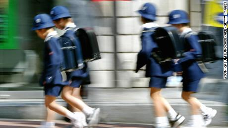 Tokyo schoolchildren make their way home from class in this 2004 file photo. Japan is experiencing its highest-ever number of reports of child abuse.