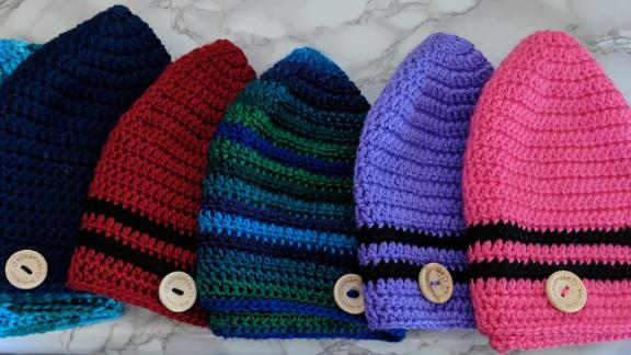 Kurt Stapleton crochets hats to help keep the heads of cancer patients warm.