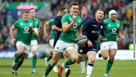 Jacob Stockdale of Ireland breaks free to score against Scotland.