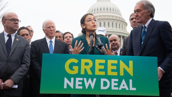 US Representative Alexandria Ocasio-Cortez, Democrat of New York, and US Senator Ed Markey (R), Democrat of Massachusetts, speak during a press conference to announce Green New Deal legislation to promote clean energy programs outside the US Capitol in Washington, DC, February 7, 2019.