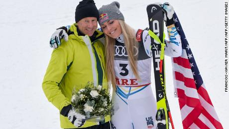 Vonn with Stenmark during the flowers ceremony after the women's downhill.