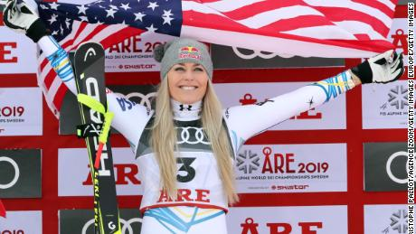 Vonn on the podium, celebrating winning bronze.