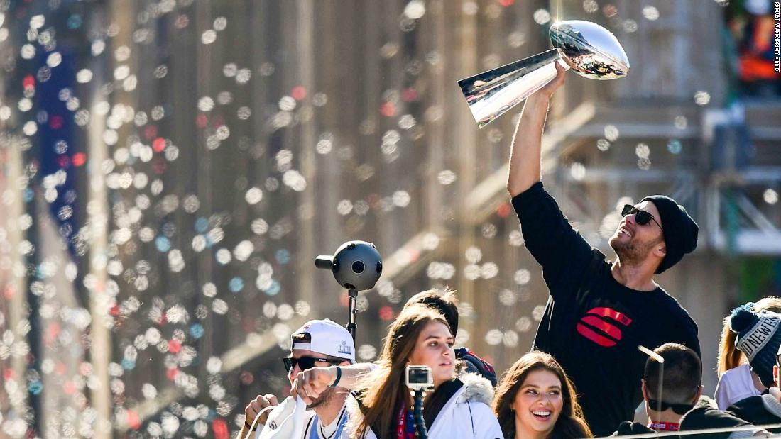 "Tom Brady lifts the Lombardi Trophy during the New England Patriots' Super Bowl parade on Tuesday, February 5. Brady has won six Super Bowls as quarterback of the Patriots. No player has won more. <a href=""http://www.cnn.com/2015/01/25/us/gallery/super-bowl-superlatives/index.html"" target=""_blank"">Photos: Super Bowl records</a>"
