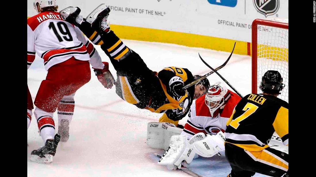 Pittsburgh's Garrett Wilson is upended during an NHL game against Carolina on Tuesday, February 5.