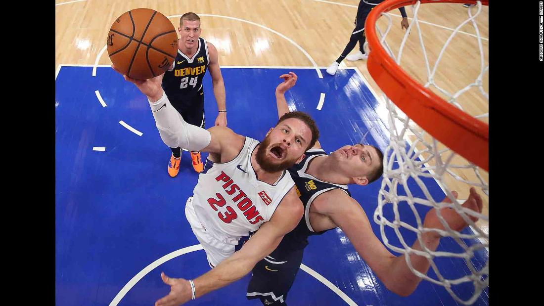 Detroit's Blake Griffin gets a shot off as he's defended by Denver's Nikola Jokic on Monday, February 4.