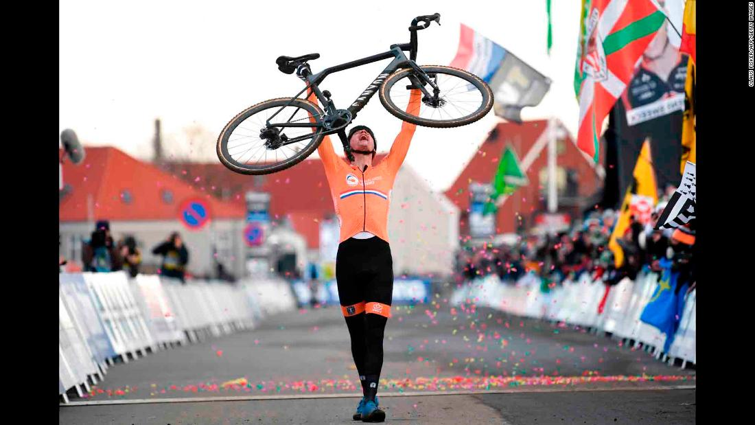 Dutch cyclist Mathieu van der Poel celebrates after winning at the Cyclo Cross World Championships on Sunday, February 3.