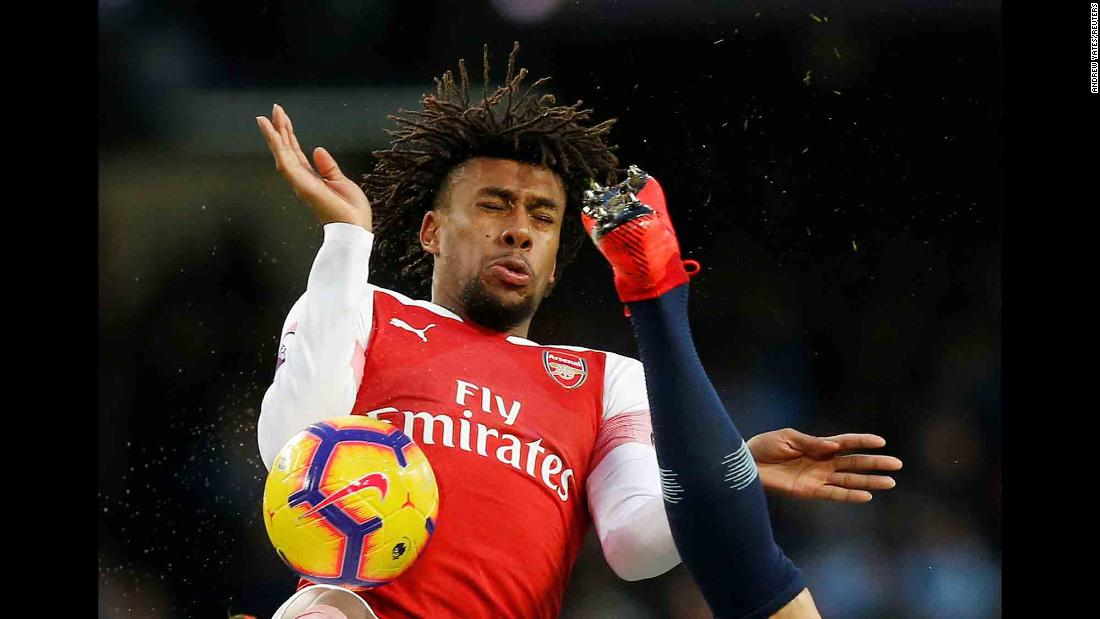 Arsenal's Alex Iwobi flinches as the boot of Manchester City's Nicolas Otamendi flies near his face during a Premier League match in Manchester, England, on Sunday, February 3.