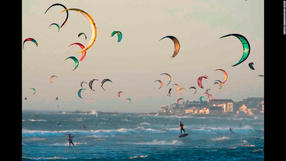 Kitesurfers take advantage of the good wind in Tableview, South Africa, on Wednesday, February 6.