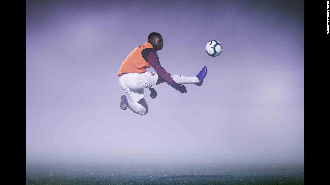 Arsenal's Jordi Osei-Tutu warms up in foggy conditions ahead of a Premier League 2 match in Borehamwood, England, on Monday, February 4.