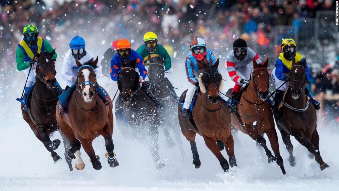 Horses race in snowy conditions in St. Moritz, Switzerland, on Sunday, February 10.
