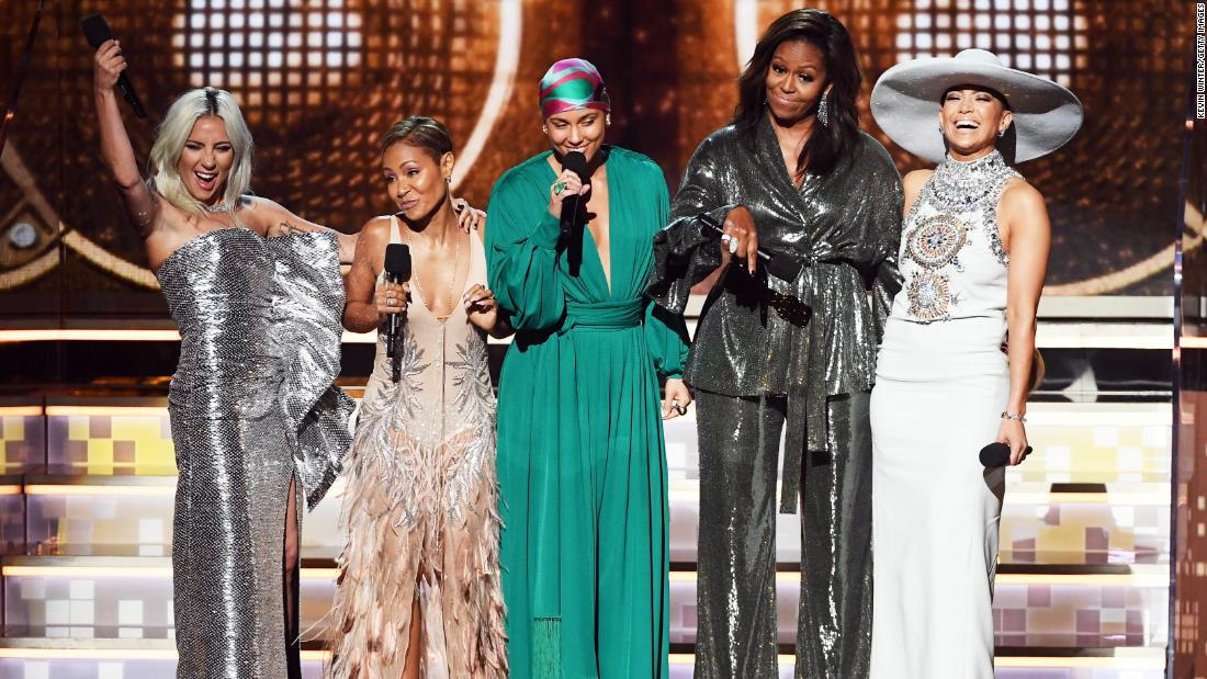 "First-time Grammys host Alicia Keys, center, was <a href=""https://www.cnn.com/entertainment/live-news/grammys-2019/h_7a5c7958193926de404b1aa4900a2799"" target=""_blank"">joined by some special company</a> as she opened the show on Sunday, February 10. With her, from left, are Lady Gaga, Jada Pinkett Smith, former first lady Michelle Obama and Jennifer Lopez. ""Music helps us share ourselves,"" Obama said. ""It allows us to hear one another."""