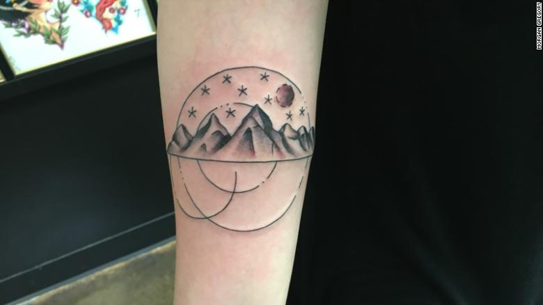"Luanne Nelson, 28, got this tattoo when she was 26. The mountains represent her love for nature. The stars and dots symbolize her friends and family, who supported and believed in her, and the moon represents a new beginning.<br /><br />The tattoo has helped her with her healing process after domestic violence and sexual assault.<br /> <br />Once the tattoo was completed, Nelson felt as if it ""had always been a part of me, that it just appeared. It felt like it belonged on me,"" she wrote in an email. <br /><br />Nelson believes in the healing nature of tattoos. She wants people to understand that survivors are everywhere. ""A part of the healing process is not being afraid to live your truth and to understand that these events may help shape you, but they do not define you,"" she added."