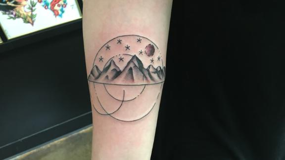 """Luanne Nelson, 28, got this tattoo when she was 26. The mountains represent her love for nature. The stars and dots symbolize her friends and family, who supported and believed in her, and the moon represents a new beginning.<br /><br />The tattoo has helped her with her healing process after domestic violence and sexual assault.<br /> <br />Once the tattoo was completed, Nelson felt as if it """"had always been a part of me, that it just appeared. It felt like it belonged on me,"""" she wrote in an email. <br /><br />Nelson believes in the healing nature of tattoos. She wants people to understand that survivors are everywhere. """"A part of the healing process is not being afraid to live your truth and to understand that these events may help shape you, but they do not define you,"""" she added."""