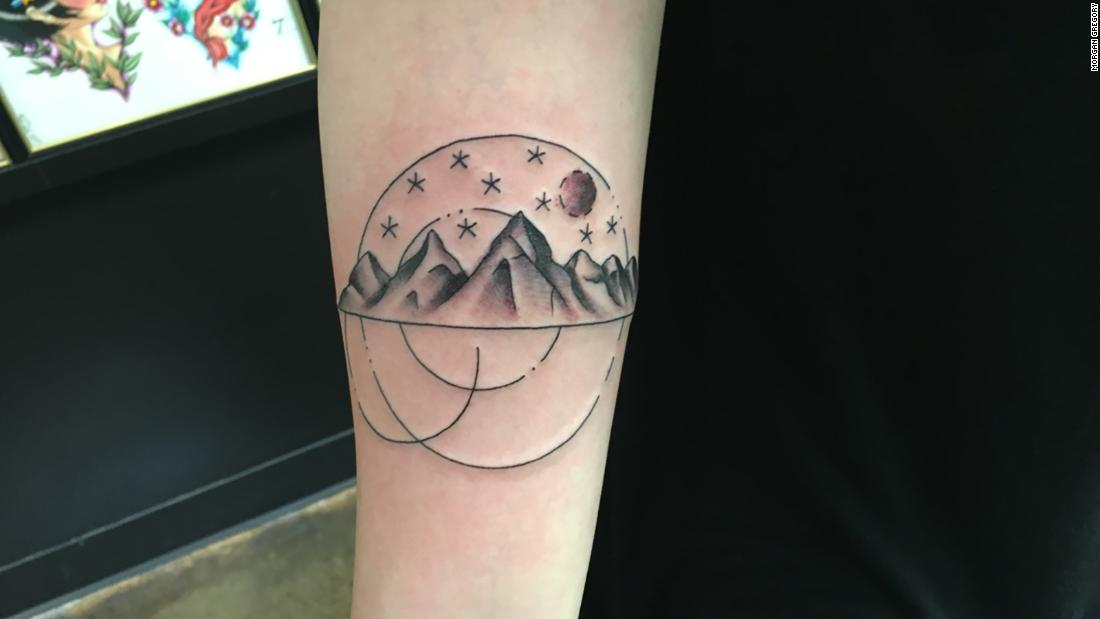 465934051397b Luanne Nelson, 28, got this tattoo when she was 26. The mountains represent